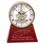 Silver Skeleton Clock on Rosewood Piano Base Sales Awards